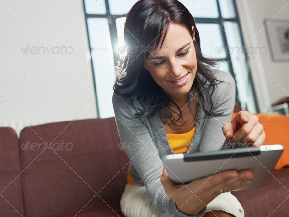 woman using tablet pc - Stock Photo - Images