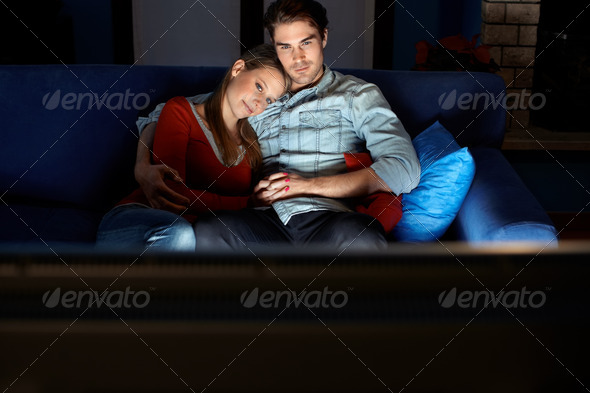 PhotoDune man and woman watching movie on tv 273255