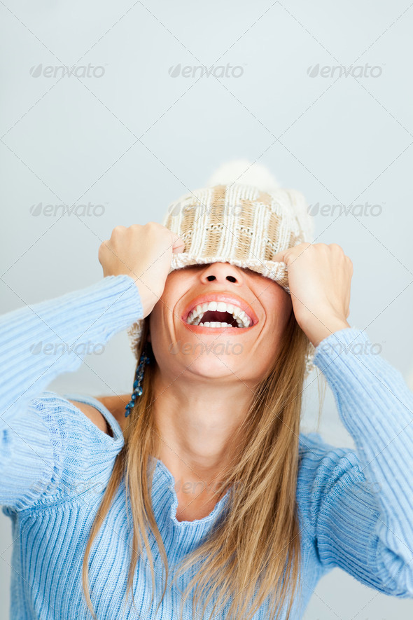 woman covering face with hat - Stock Photo - Images