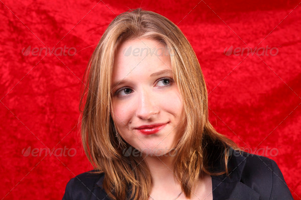 Portrait of a young woman with red velvet - Stock Photo - Images