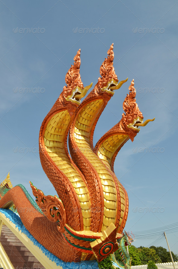 Thai dragon, King of Naga statue with three heads in Thailand - Stock Photo - Images