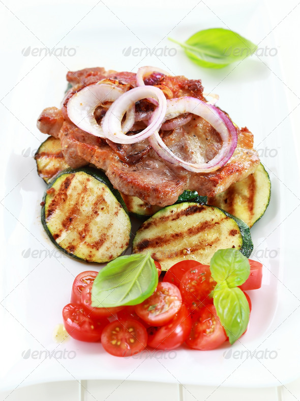 Pan-fried pork steak  with grilled vegetable - Stock Photo - Images