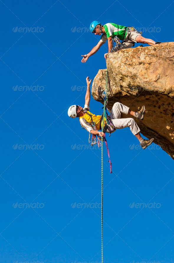Climbing team struggles to the summit. - Stock Photo - Images