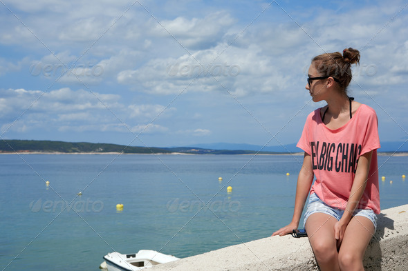 Teenage girl looking at the sea - Stock Photo - Images