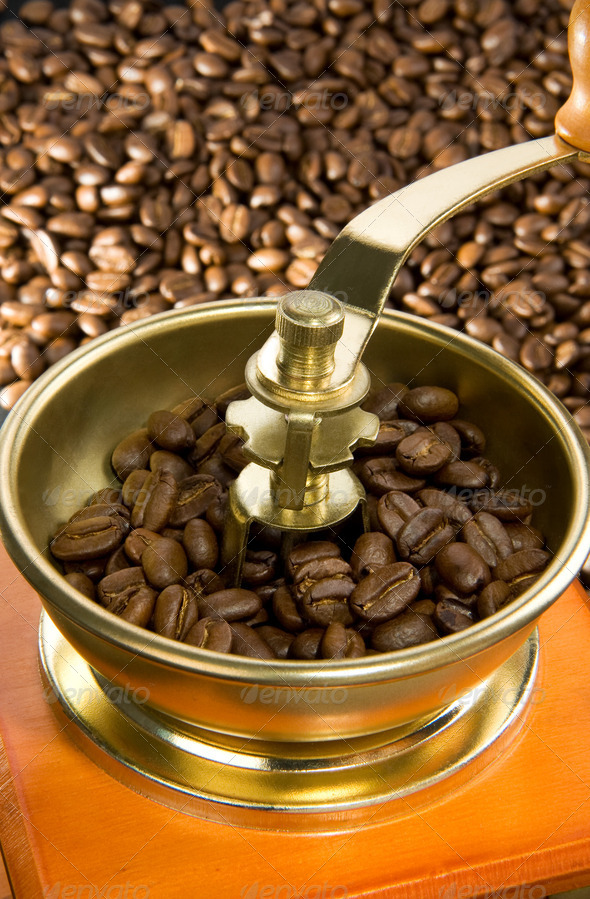 coffee grinder and roasted beans - Stock Photo - Images