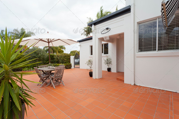 Modern backyard with table - Stock Photo - Images