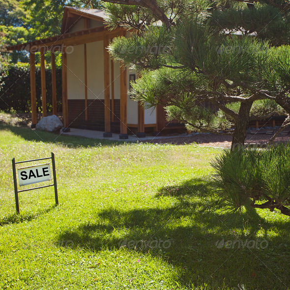 house in Japanese style on background of trees and card sale - Stock Photo - Images