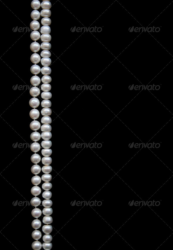 White pearls on the black silk - Stock Photo - Images