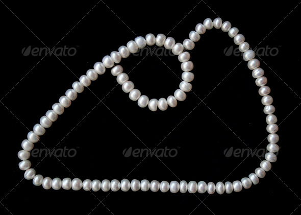 White pearls on the black silk as background - Stock Photo - Images