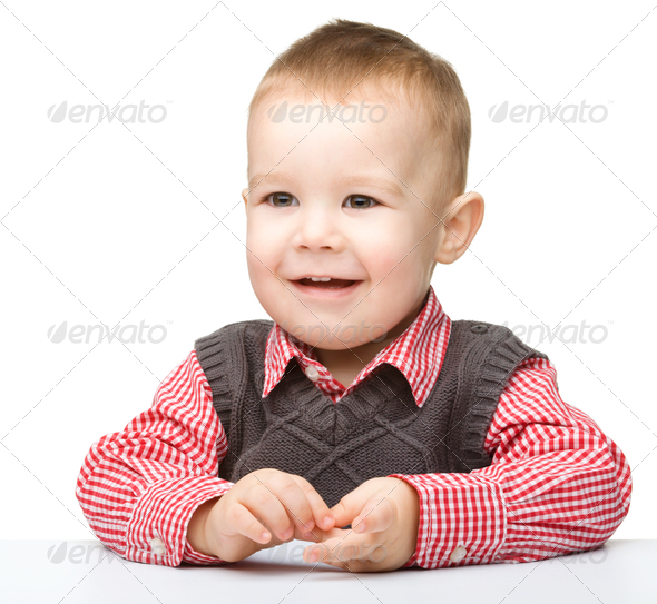 Portrait of a cute cheerful little boy - Stock Photo - Images
