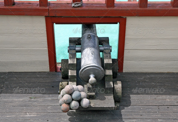 cannon with balls in a ship of Pirates of the Caribbean - Stock Photo - Images