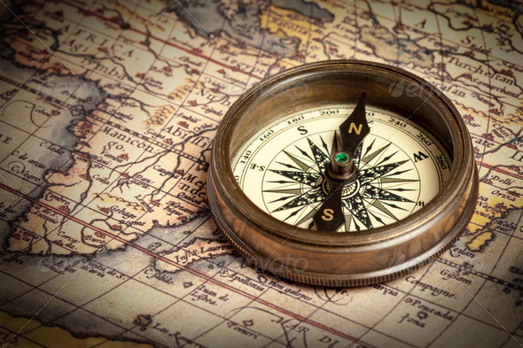 Old vintage compass on ancient map - Stock Photo - Images