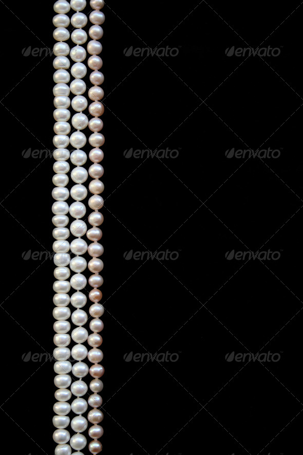 White and pink pearls on the black silk - Stock Photo - Images