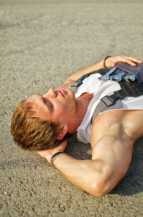 Tired mechanic resting on the road - Stock Photo - Images