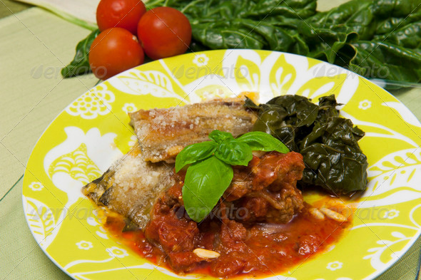 meat rolls in tomato sauce served with spinach - Stock Photo - Images