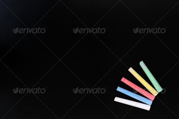 Colorful chalk on a blank blackboard  - Stock Photo - Images