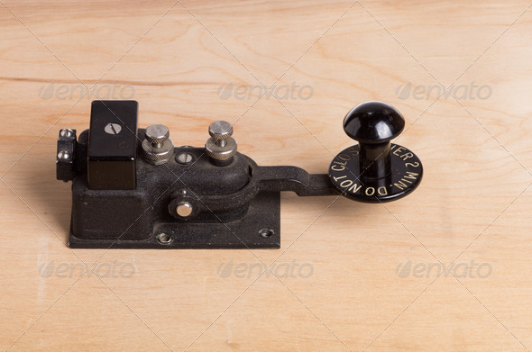 Vintage telegraph key on desk - Stock Photo - Images