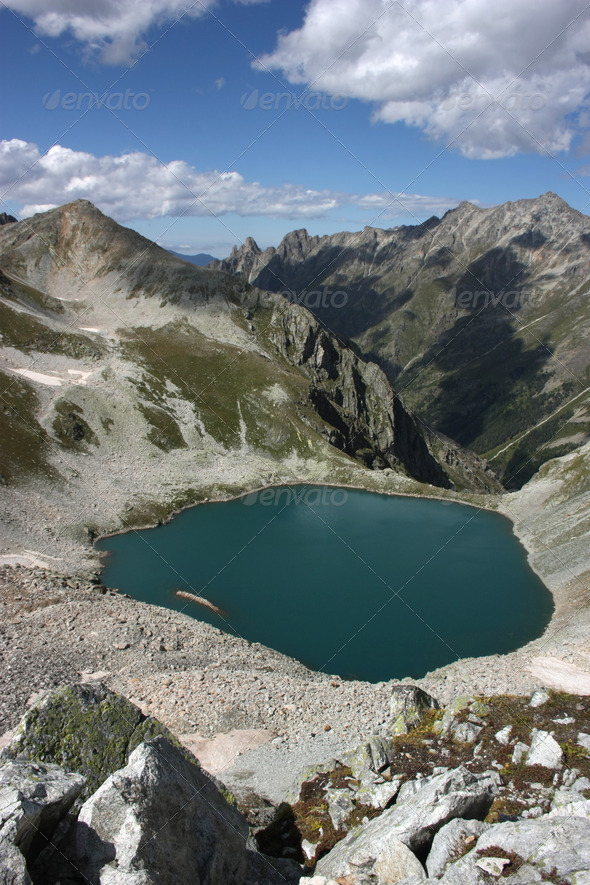 Lake in mountains. Alpine latitudes at different times of the ye - Stock Photo - Images