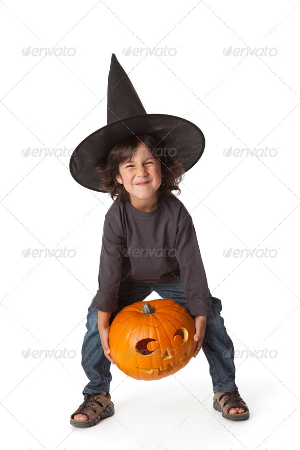 Little boy is lifting a Halloween pumpkin - Stock Photo - Images