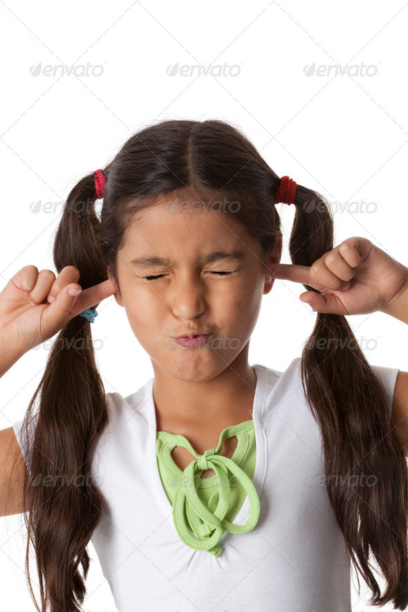 Little girl is closing her ears with her fingers - Stock Photo - Images