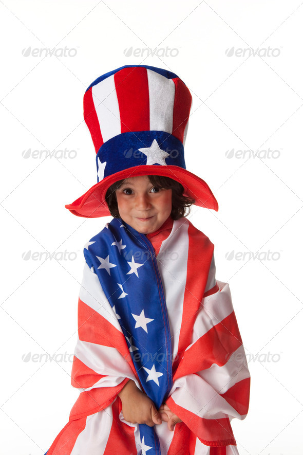 Little boy dressed in a flag and hat from Uncle Sam - Stock Photo - Images