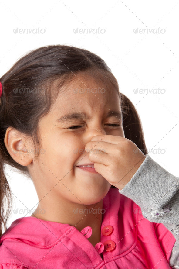Little girl is closing her nose with her fingers - Stock Photo - Images