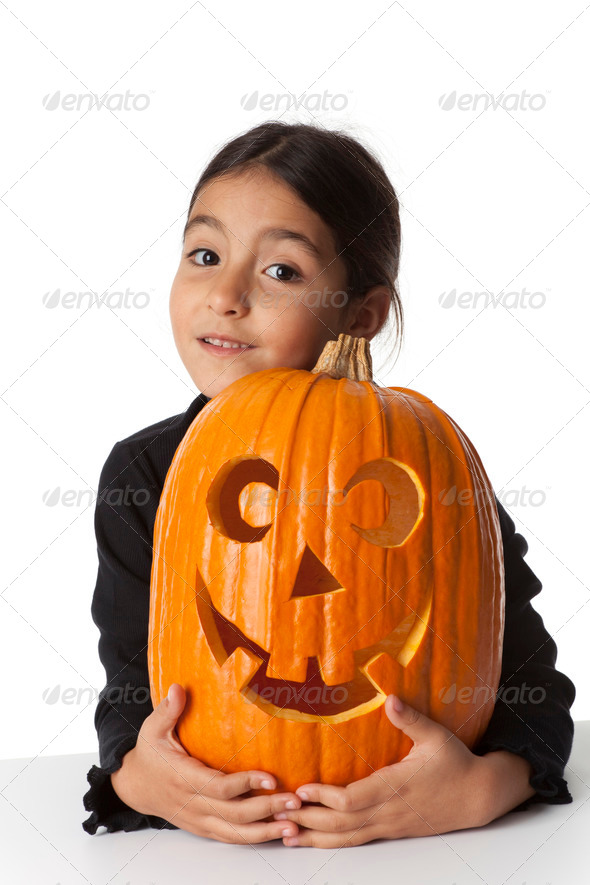 Little girl with a Halloween pumpkin - Stock Photo - Images