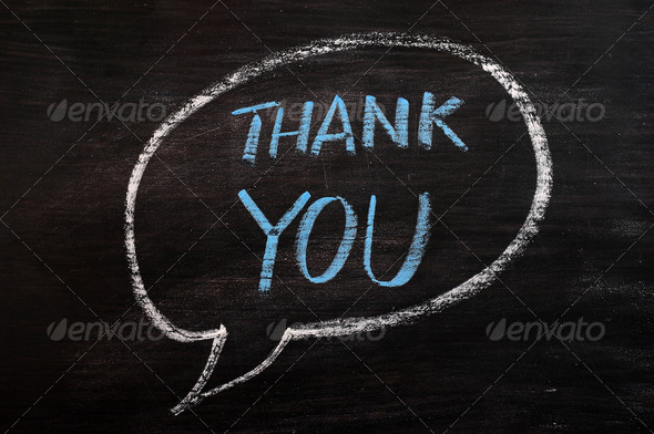Thank you written in a speech bubble with blue chalk on a smudged blackboard - Stock Photo - Images