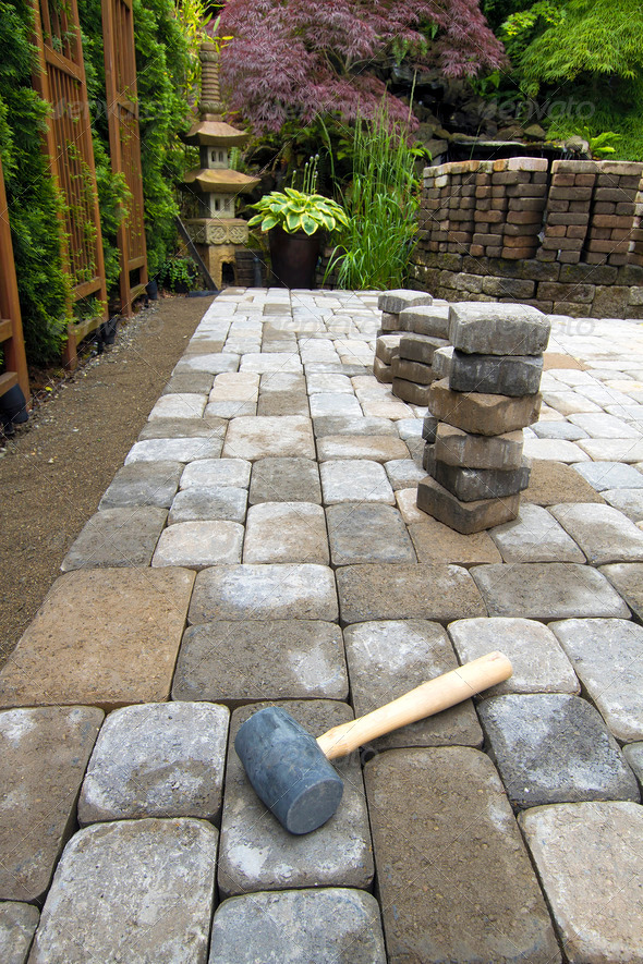 Laying Garden Pavers Patio - Stock Photo - Images