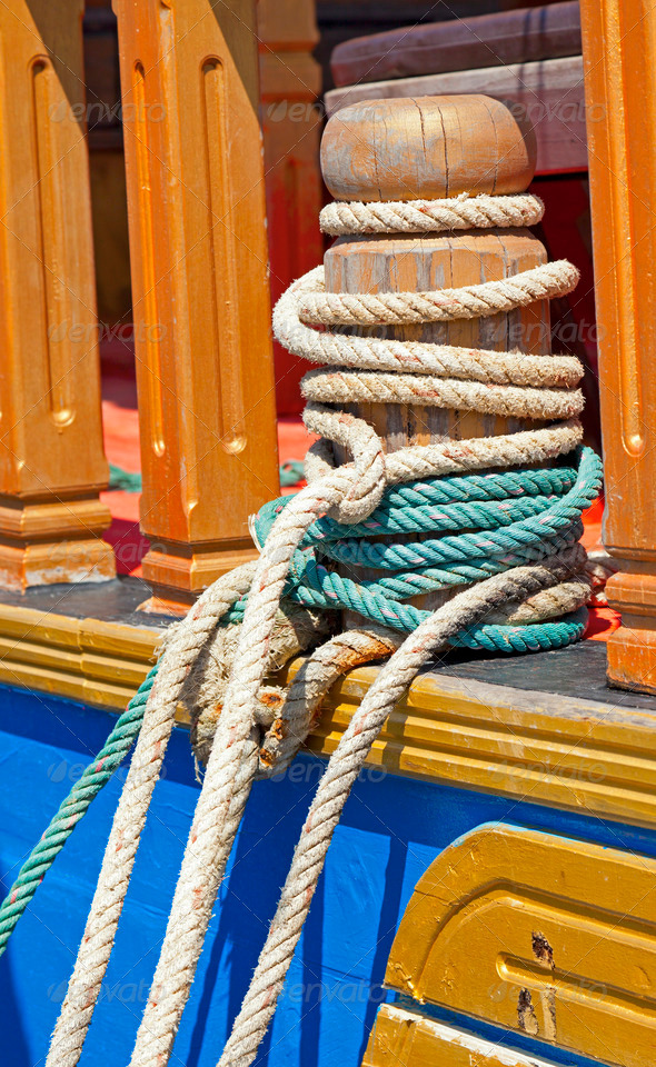 Mooring bollard with ropes - Stock Photo - Images