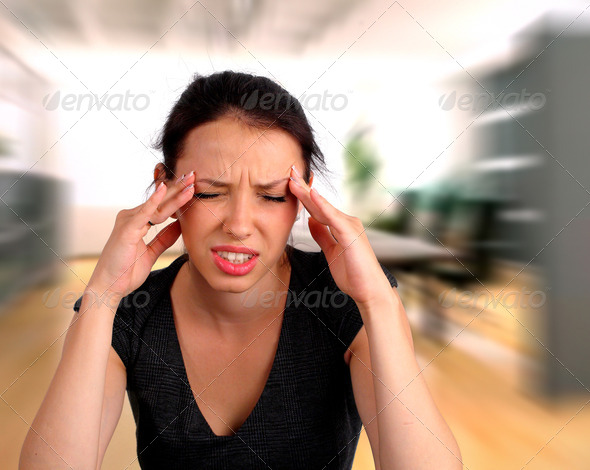 Woman heaving a headache - Stock Photo - Images