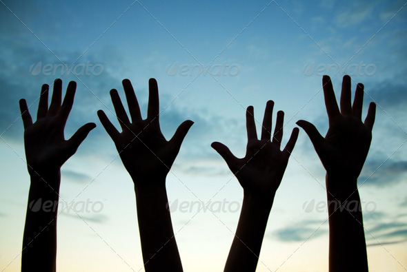 Four raised hands - Stock Photo - Images