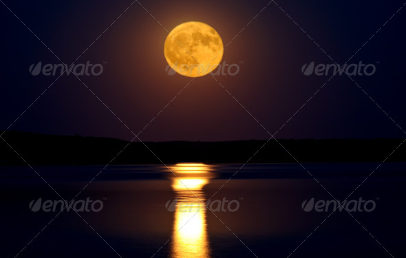 Full moon reflected on water - Stock Photo - Images