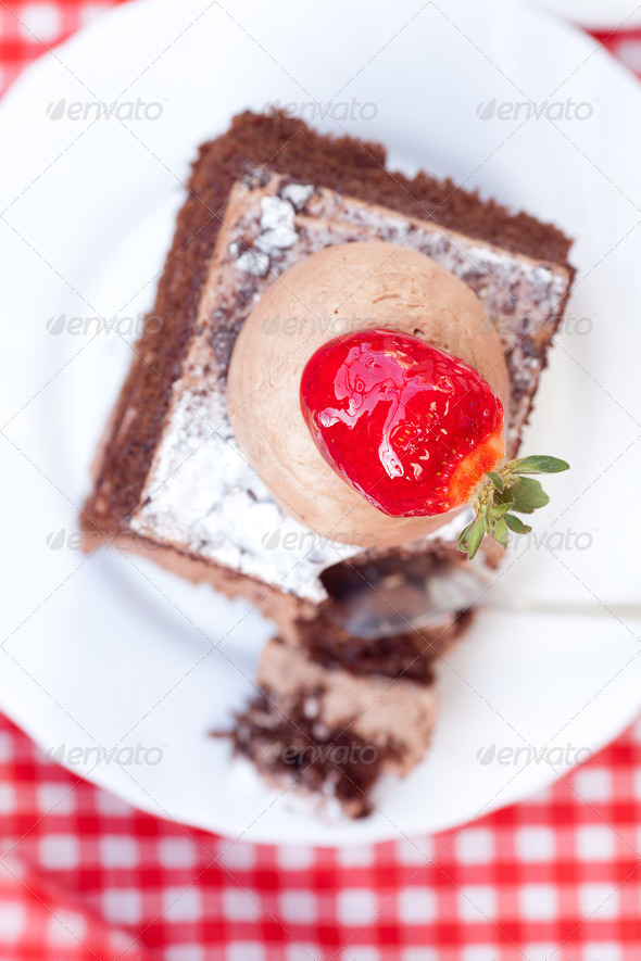 beautiful cake with strawberry on plaid fabric - Stock Photo - Images