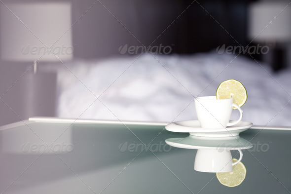 tea with lemon on the background of the bed and the lamp - Stock Photo - Images