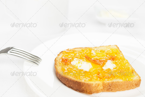 Breakfast. French toast, orange marmalade, butter, fork and white cup - Stock Photo - Images
