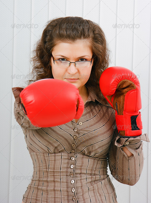 Business woman with boxing gloves - Stock Photo - Images