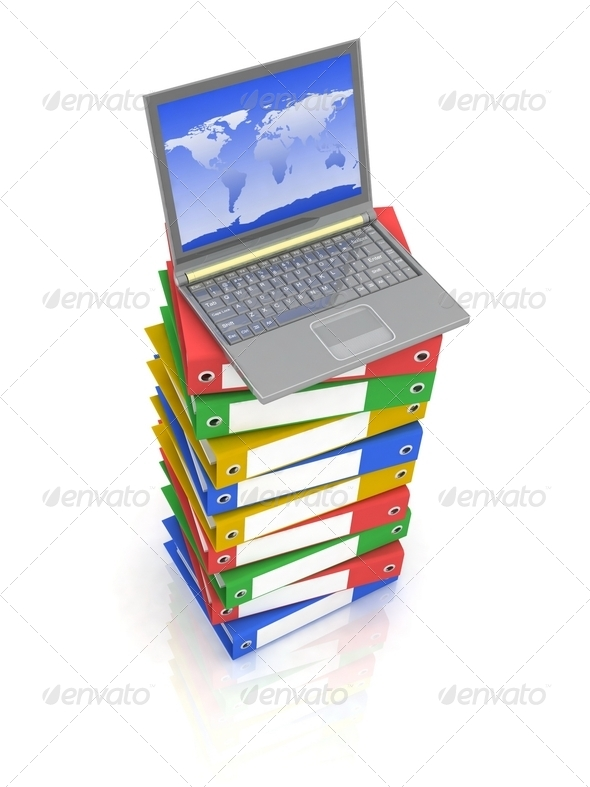 Colorful Books next to a modern Laptop - Stock Photo - Images