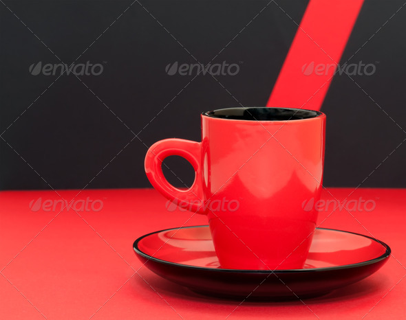Red coffee cup on a black background - Stock Photo - Images