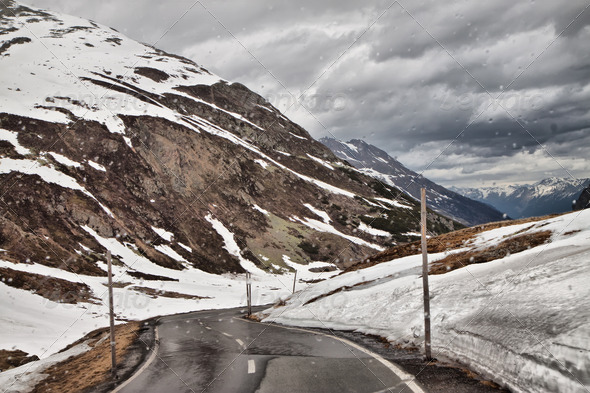 The road to the Alps in the rain. - Stock Photo - Images