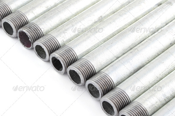 Line of iron water pipe with strand on white floor. - Stock Photo - Images