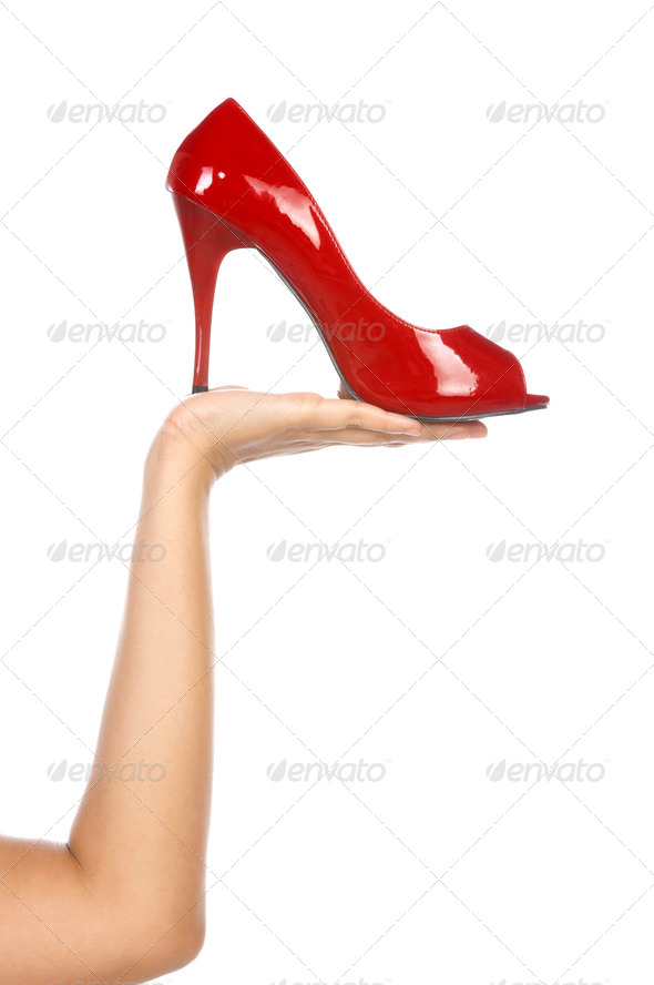 Holding Red Shoe - Stock Photo - Images