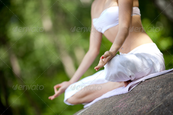 Young girl doing yoga in the park - Stock Photo - Images