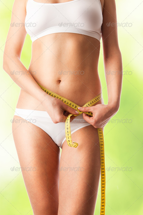 Woman measuring her body . - Stock Photo - Images