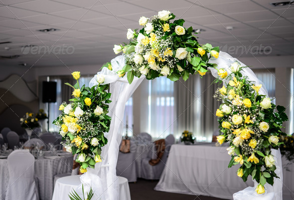 Beautiful wedding flower arch decoration in restaurant - Stock Photo - Images