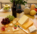 Selection of cheese and crackers with wine and a cheese knife - PhotoDune Item for Sale