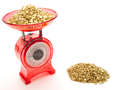 Red kitchen scales with a pile of gold being weighed - PhotoDune Item for Sale