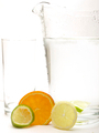 Slice of Lemon, Lime and Orange with a empty glass and jug of water - PhotoDune Item for Sale