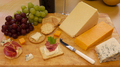 Selection of cheese and crackers served on a wooden board - PhotoDune Item for Sale