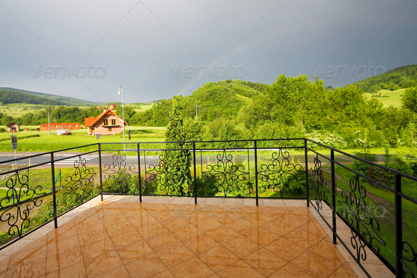 Panorama of the green mountain from a balcony - Stock Photo - Images